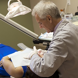 Dr. Carroll treating patient in dental chair