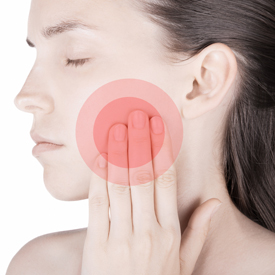Woman holding cheek to indicate tooth pain