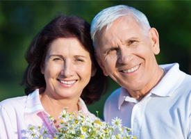 Smiling senior couple outdoors