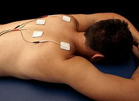 man with electrodes placed on back