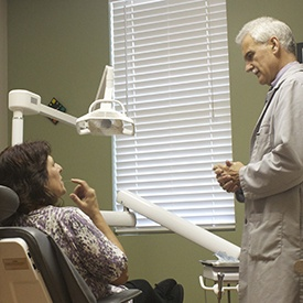 Dr. Carroll talking to patient in dental chair